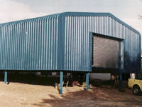 Enclosed structure with bullnose and roller shutter door – Chromadek.