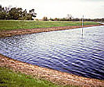 Erosion control on the banks of lakes and reservoirs is acheived with Tensar Mats.